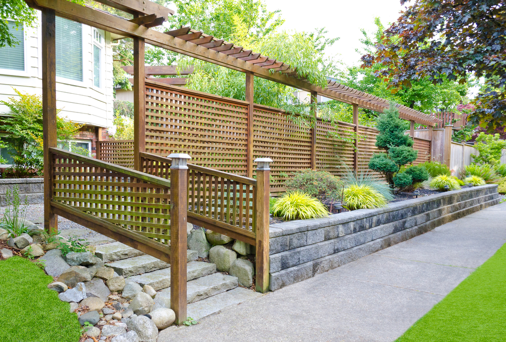 A timber fence skirting the outside of a home